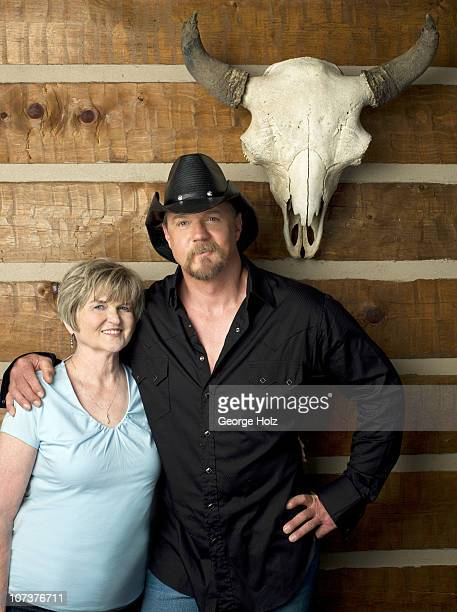 Country singer Trace Adkins with mother Peggy Adkins pose at a portrait session for People Country on July 15 2010 in Brentwood Tennessee