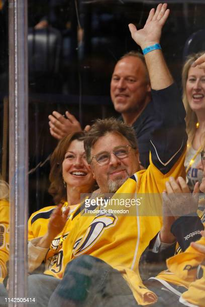 Country singer Vince Gill waves to fans after being wished a happy birthday on the jumbotron during the first period between the Nashville Predators...