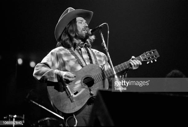 Country singer Willie Nelson performs with Waylon Jennings at the Omni Coliseum on March 2, 1978 in Atlanta, Georgia.