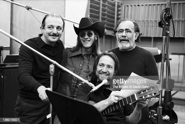 Country singer Willie Nelson recording in the studios of Atlantic Records behind him are L-R Arif Mardin, Doug Sahm and Jerry Wexler, in February...