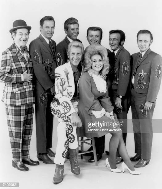 Country singers and collaborators Porter Wagoner and Dolly Parton pose for a portrait with their back up band The Wagonmasters in circa 1968 Mr...