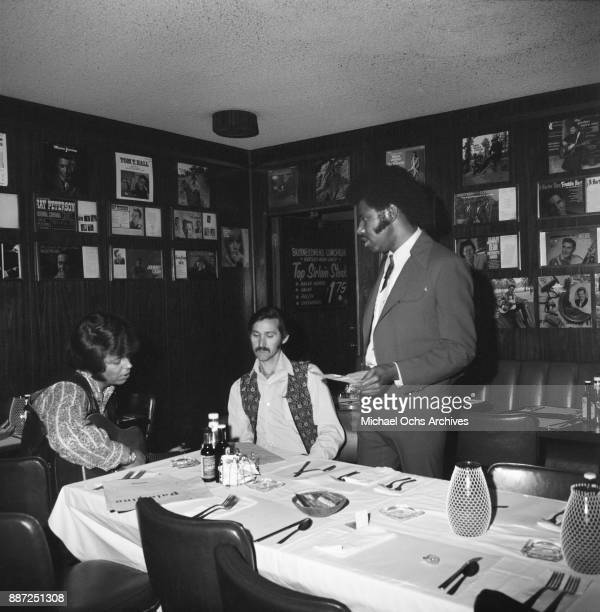 Country singers and songwriters O B McClinton and Tony Booth pose for a photo at a press party at The Palomino Club on March 20 1972 in the North...