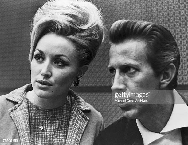 Country singers Dolly Parton and Porter Wagoner in a candid portrait in circa 1968 in Nashville Tennessee