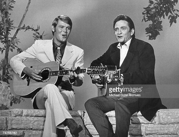 """Country singers Glen Campbell and Johnny Cash appear together with acoustic guitars on """"The Johnny Cash Show"""" on July 12, 1969."""