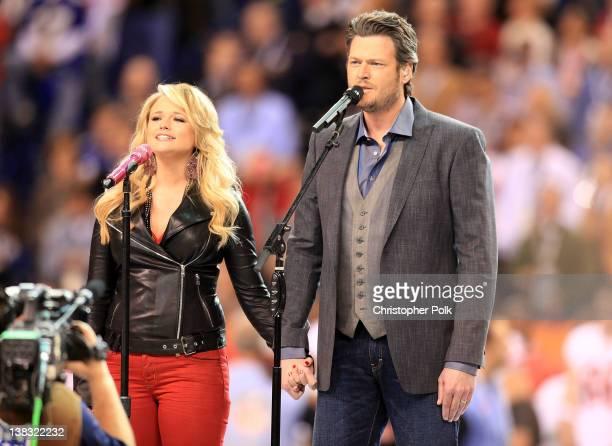 "Country singers Miranda Lambert and Blake Shelton perform ""America the Beautiful"" during the Bridgestone Super Bowl XLVI Pregame Show at Lucas Oil..."