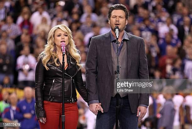 "Country singers Miranda Lambert and husband Blake Shelton perform ""America the Beautiful"" before the start of Super Bowl XLVI at Lucas Oil Stadium on..."