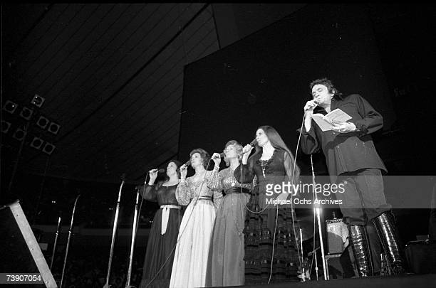 Country singer/songwriter Johnny Cash performs onstage with the Carter Sisters at the Anaheim Convention Center on March 11, 1978 in Anaheim,...
