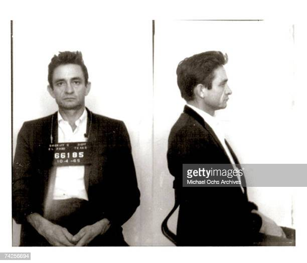 Country singer/songwriter Johnny Cash poses for a mug shot after US Customs agents found hundreds of pep pills tranquilizers in his luggage as he...