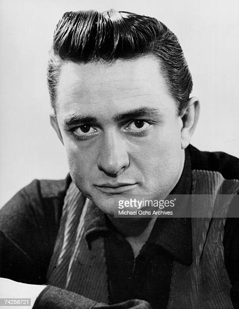 Country singer/songwriter Johnny Cash poses for a portrait in circa 1957