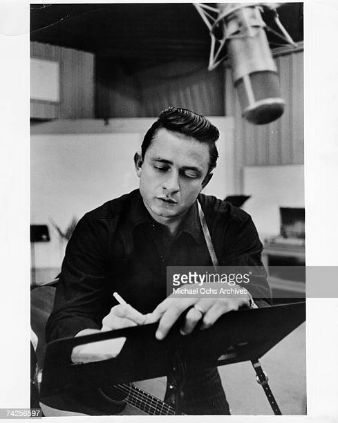 Country singer/songwriter Johnny Cash records in the studio in 1960.