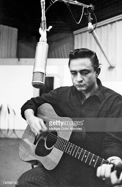 Country singer/songwriter Johnny Cash records in the studio in circa 1960