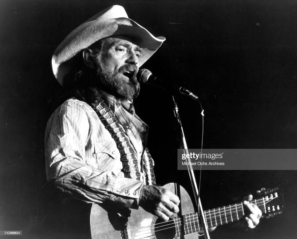 Country singer/songwriter Willie Nelson plays acoustic guitar as he performs onstage in circa 1976.