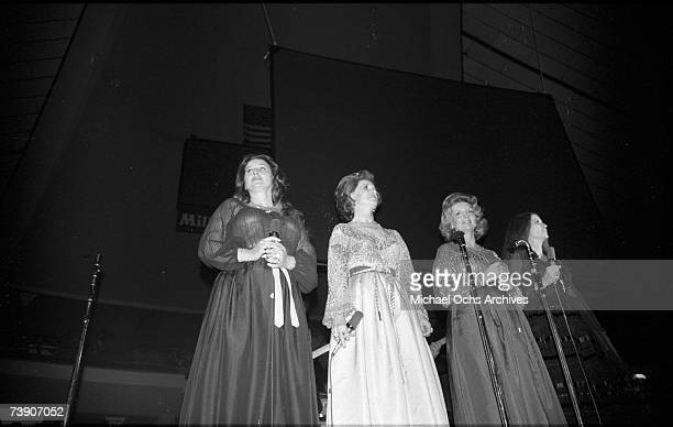 Country singing group the Carter Sisters with Jan Howard perform onstage with Johnny Cash at the Anaheim Convention Center on March 11, 1978 in...