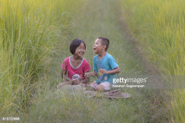 country song - very young thai girls stock photos and pictures