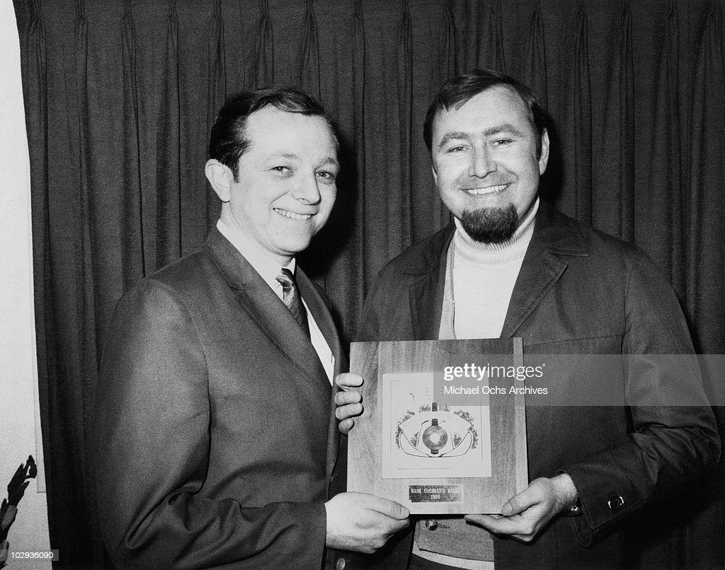 Country songwriter and singer Hank Cochran receives an award in 1968 in Nashville City, Tennesee.