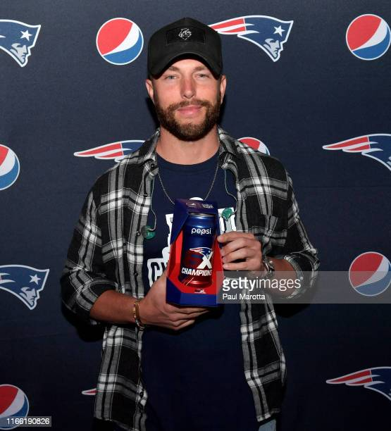 Country star Chris Lane with Pepsi's Limited Edition Patriots Laces Shaped Can during Pepsis Celebrating the Champs Kickoff Event at Gillette Stadium...