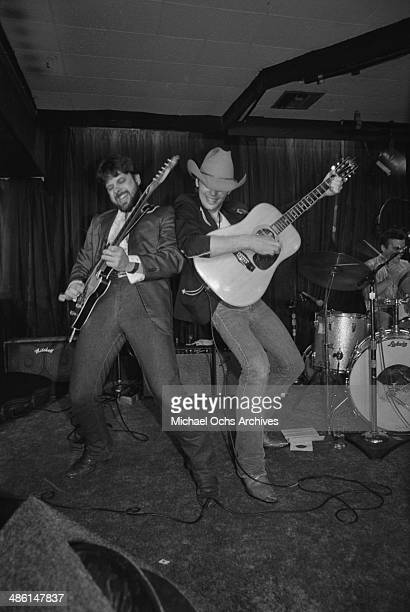 Country star Dwight Yoakam performs with his guitarist Pete Anderson at the Palonino club on August 24 1985 in Los Angeles California