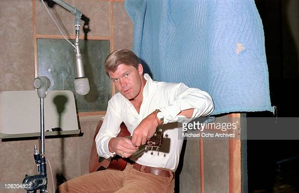 Country star Glen Campbell recorsds at the Capitol Records studios on June 1 1967 in Los Angeles California