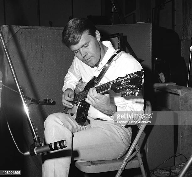 Country star Glen Campbell sits in on an Everly Brothers recording session at United Western Recorders on January 7, 1967 in Los Angeles, California.