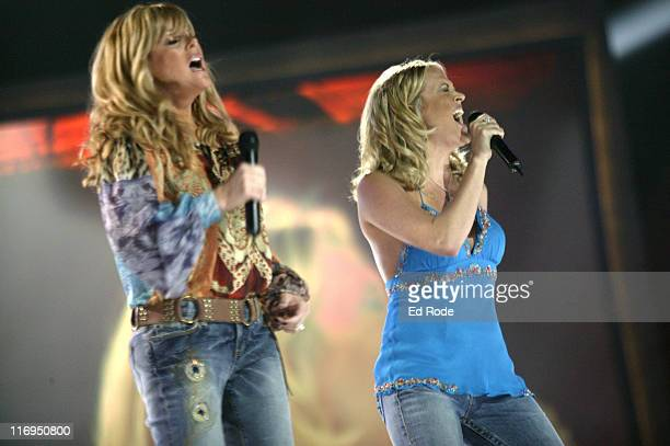 Country star Jamie O'Neal and 'American Idol' winner Carrie Underwood perform the legendary duet 'Does He Love You' at the CMT's 100 GREATEST DUETS...