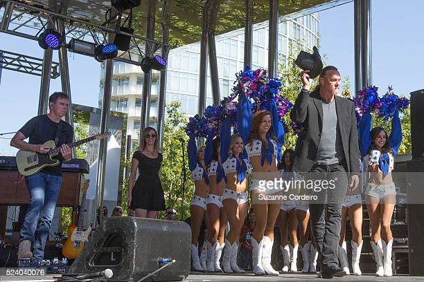 Country star Trace Adkins performs in concert surrounded by the Dallas Cowboys Cheerleaders at Carnival's Ultimate Cowboys Fan Fest on October 18...