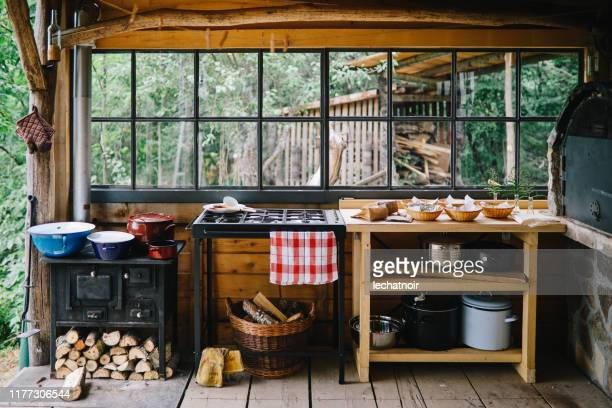 country style outdoors kitchen - cottage exterior stock pictures, royalty-free photos & images