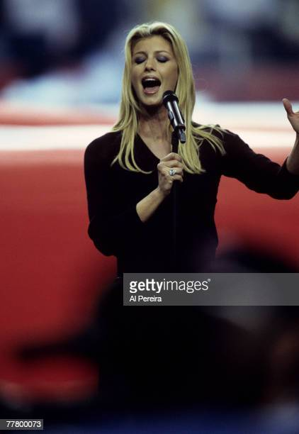 Country superstar Faith Hill performs the National Anthem before Super Bowl XXXIV a 2316 St Louis Rams victory over the Tennessee Titans on January...