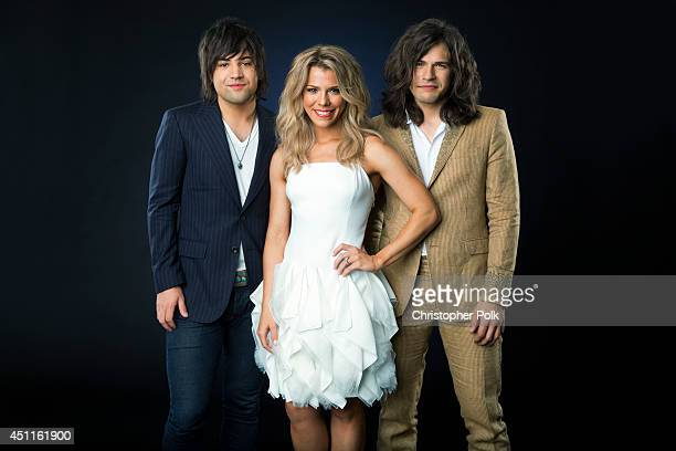 Country trio The Band Perry Kimberly Perry Reid Perry Neil Perry are photographed at the CMT Music Awards Wonderwall portrait studio on June 4 2014...