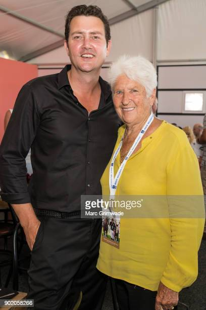 Country western singer Adam Harvey and swimming legend Dawn Fraser attend Magic Millions Polo on January 7 2018 in Gold Coast Australia