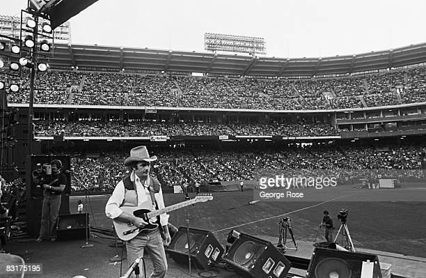 Country western singer and guitarist Merle Haggard performs at an outdoor 1980 Anaheim California concert at Anaheim Stadium