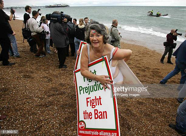 Countryside Alliance supporter walks up the beach after jumping in the sea outside the conference centre in Brighton currently hosting the Labour...