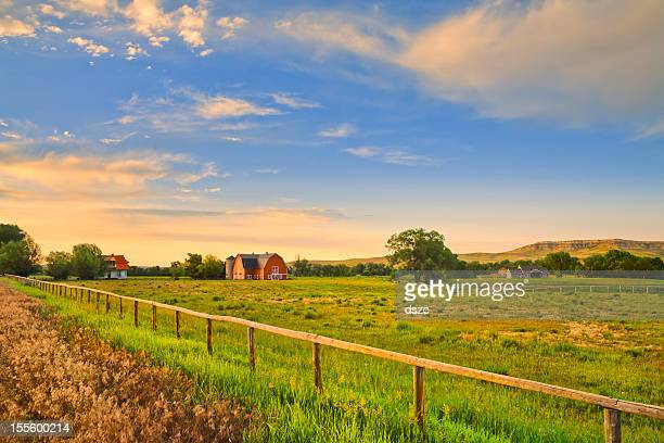 countryside and farms at sunset in rural montana - farmhouse stock pictures, royalty-free photos & images