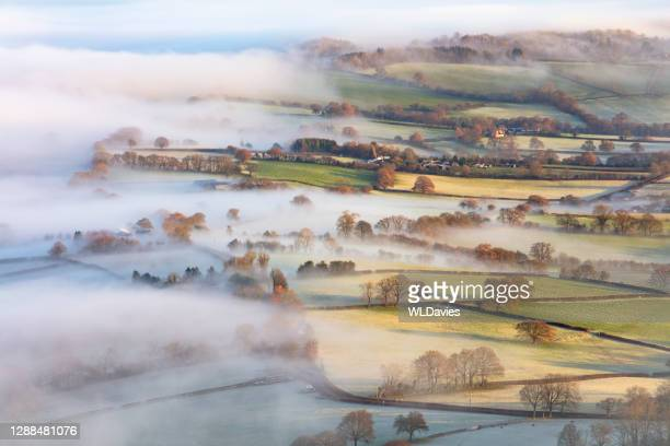 countryside in mist - south wales stock pictures, royalty-free photos & images