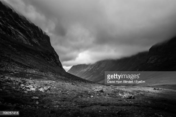 countryside landscape against mountain range - norrbotten province stock photos and pictures