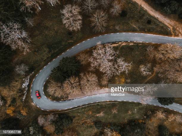 countryside road in autumn as seen from above - hairpin curve stock photos and pictures