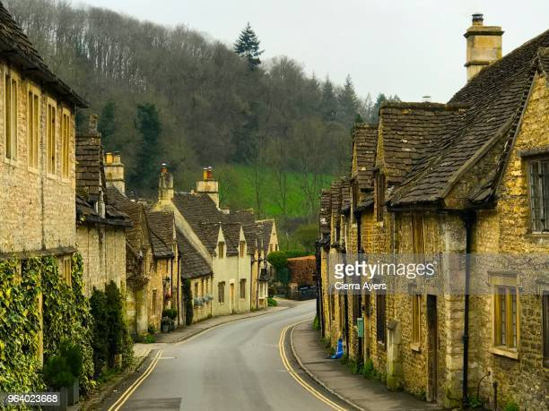 countryside road in castle combe - town stock pictures, royalty-free photos & images