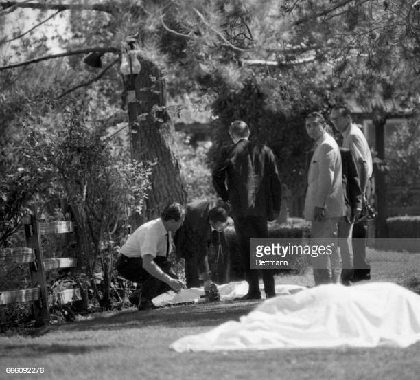 LA County coroner's office take notes and look at the bodies found on the lawn of the Sharon TateRoman Polanski home Five people were discovered...