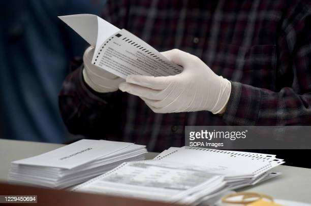 County employee opens mail-in ballots at the Luzerne County Bureau of Elections. As the polling stations in Pennsylvania state close, the ballots for...