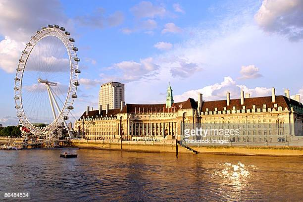 county hall with the london eye and river thames - london eye stock pictures, royalty-free photos & images