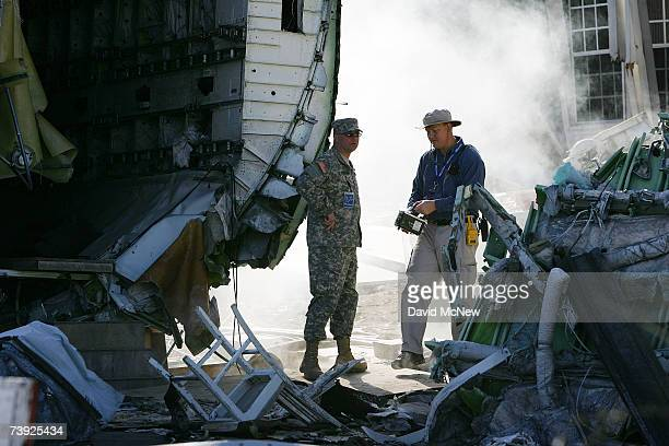 County of Los Angeles Department of Health Services Health Physicist Jeffery Day and a member of the California National Guard prepare the site...