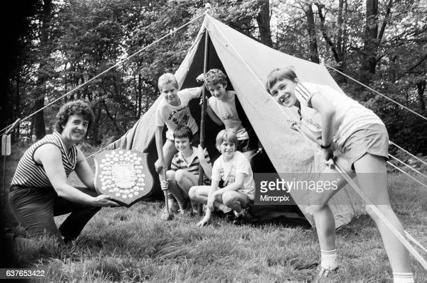 County scout secretary Mrs Margaret Hunter shows off the winner's shield to members of the 15th Cowcliffe Spider patrol, who were taking part in the...