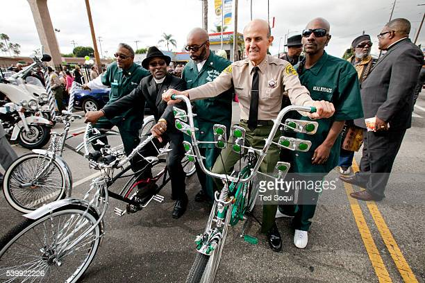 LA County Sheriff Lee Baca poses on a lowrider bicycle Thousands of people lined the streets of Southwest Los Angeles today for the 27th annual...