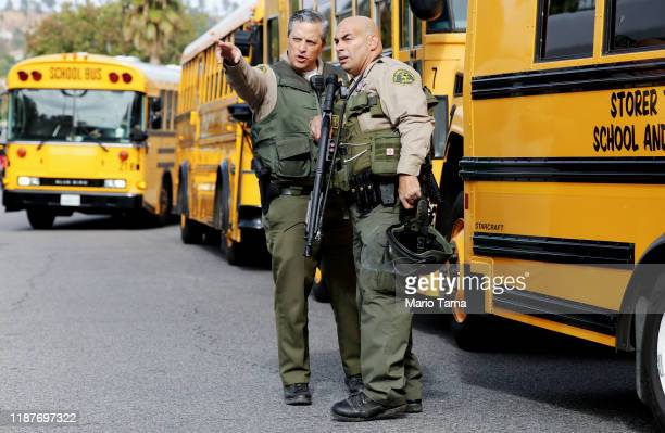 A County sheriff's deputies keep watch near Saugus High School after a shooting at the school left two students dead and three wounded on November 14...