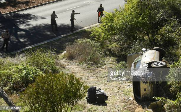 County Sheriff's officers investigate an accident involving famous golfer Tiger Woods along Hawthorne Blvd. In Ranch Paos Verdes Tuesday.