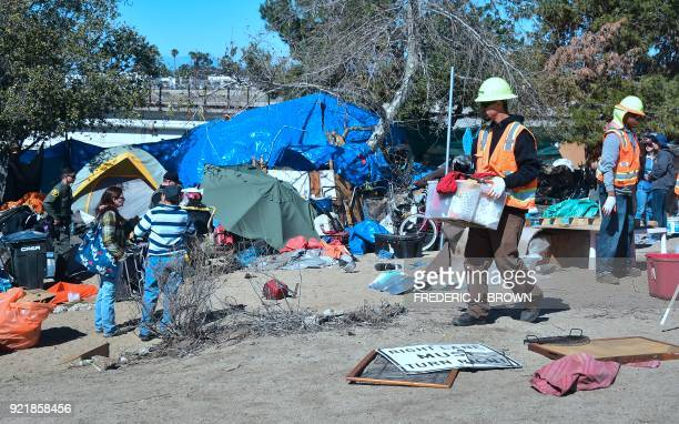 County workers clear and raze a homeless encampment beside the Santa Ana River on February 20 2018 in Anaheim California Officials in Orange County...