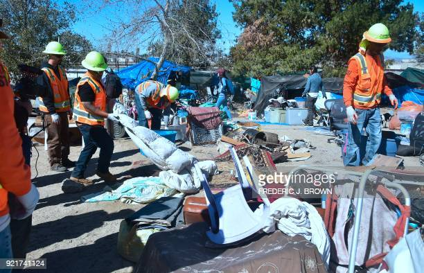County workers raze and clear the homeless encampment beside the Santa Ana River in Anaheim California on February 20 2018 Officials in Orange County...
