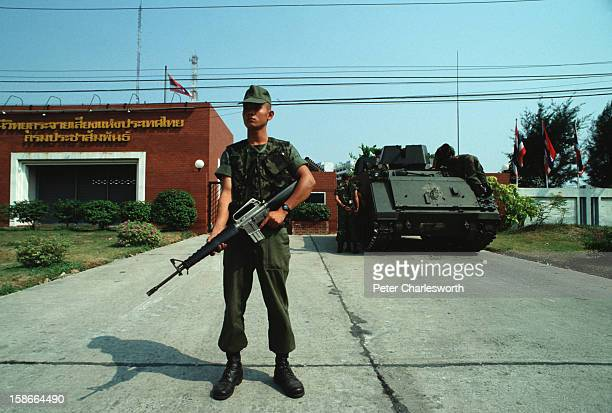 Coup d'etat in Thailand A soldier and an Armored Personnel Carrier loyal to the February 1991 coup leaders stands guard outside the Radio Thailand...