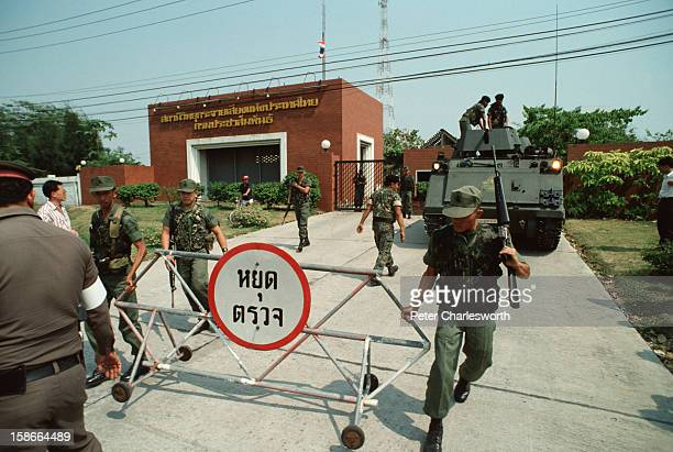 Coup d'etat in Thailand Soldiers and an Armored Personnel Carrier loyal to the February 1991 coup leaders block the road outside the Radio Thailand...