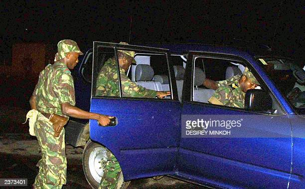 Coup leader Major Fernando Pereira gets into a car at the end of a meeting with international negotiators that carried on till the early hours in Sao...