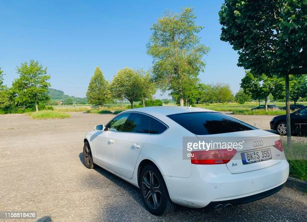 audi  a5 tdi coupe, white, in public parking spot, rear view - audi stock pictures, royalty-free photos & images
